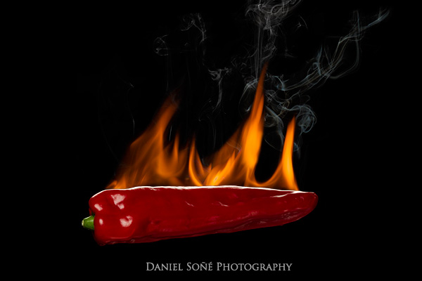 The final result after nearly an hour of trial-and-error. I used Photoshop to clean up the background, remove the skewers and clamp, and dodge-burn to enhance the pepper's shape as well as the flame. (Photo: Daniel Soñé Photography)