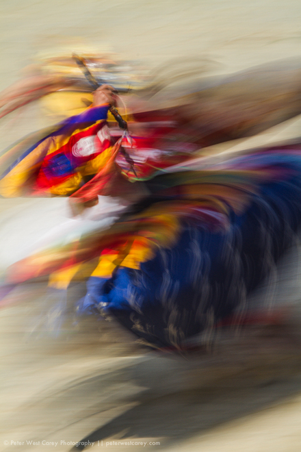 A Bhutanese monk spins in a circle while performing a masked dance during the Paro Tsechu in Paro, Bhutan.