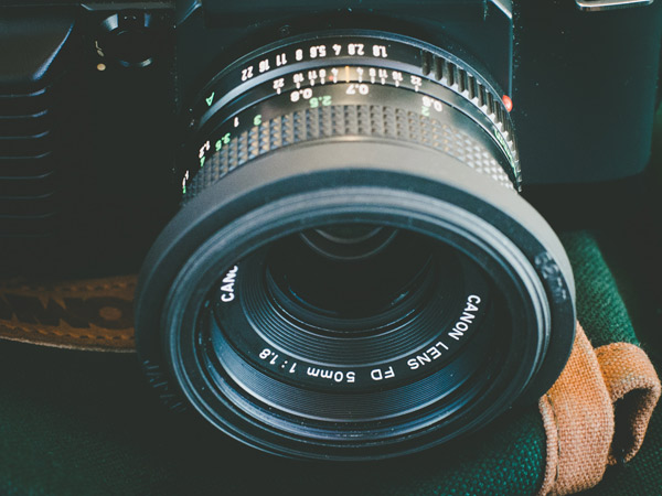 The 50mm f/1.8 lens is one thing that is frequently recommended, and with good reason. With the wide aperture, you can take on low light situations and limit depth of field in creative ways.