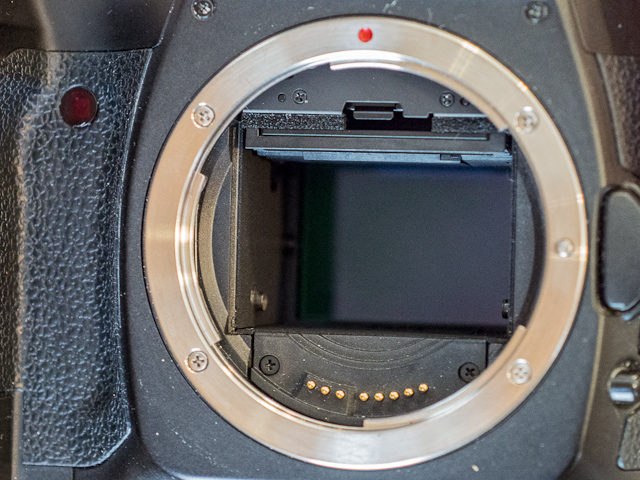 The full frame sensor of the Canon 5D is much larger than APS-C sized DSLRs