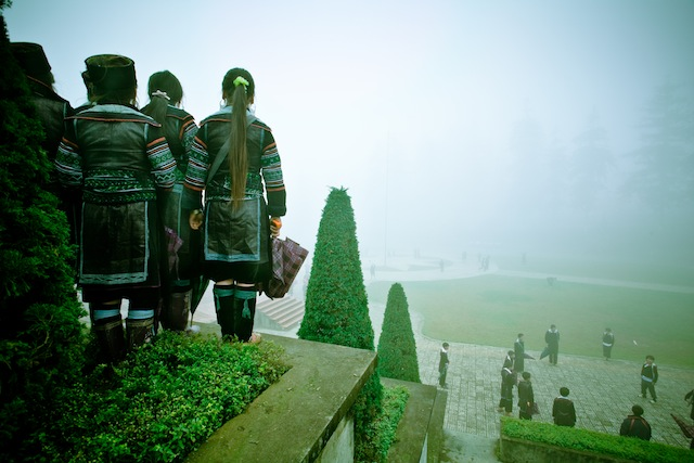 Hmong girls overlook schoolboys playing games during Tet. Sapa, Vietnam.
