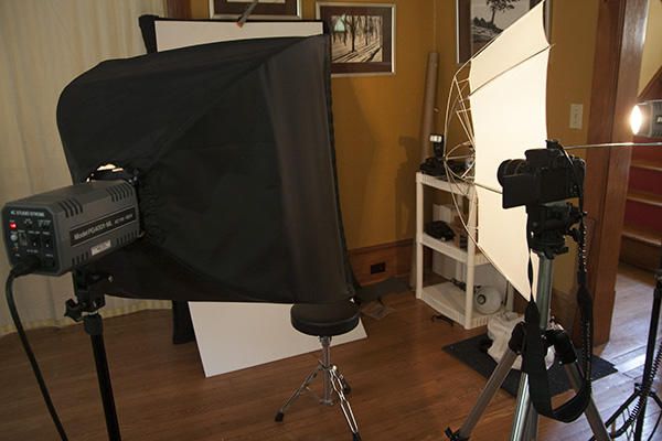 Even against two 160Ws strobes on 1/2 power, the ~60Ws speedlight only had to be on 1/32 due to the efficiency of reflective surfaces.