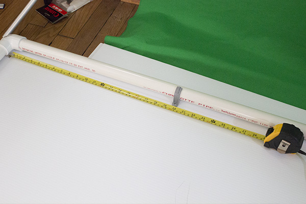Measure the section, then measure half way along. Easier than trying to place the clamp halfway along in one go.