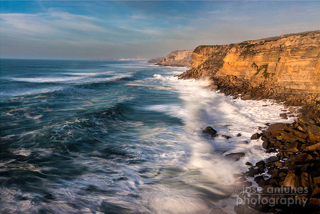 This image was taken as the sun was going down. Compare it with the next image, on the same stretch of the Portuguese coast, taken at Blue hour
