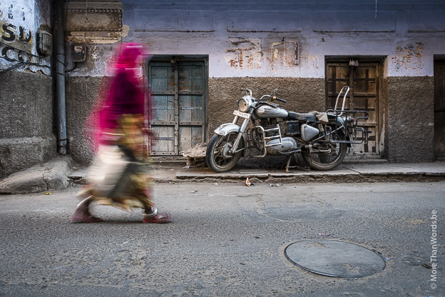 I like to experiment with shutter speeds. In this case, the Royal Enfield in this gritty alleyway in Pushkar provided to be the perfect backdrop. Again, all I had to do was wait for people to pass by. I took about 60 images, experimenting to find the right amount of blur: too much and the person would become unrecognizable, too little and it would look as if I had poorly focused. I finally settled on 1/8 of a second, which I could still handhold thanks to the built-in image stabilization in the 18-55 mm Fuji zoom lens.